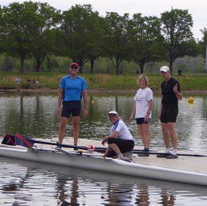 Spring break rowers in Oak Ridge on dock with oars