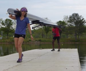 Spring break rowers in Oak Ridge on dock carrying double