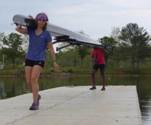 Spring break rowers in Oak Ridge on dock carrying double